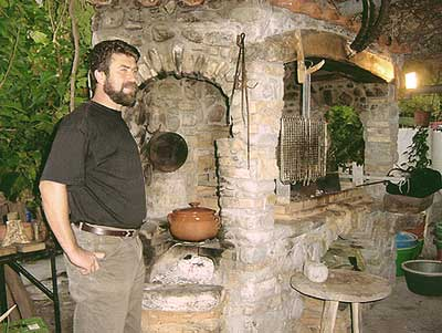 Roussos Viglis by the traditional open fire cooking place